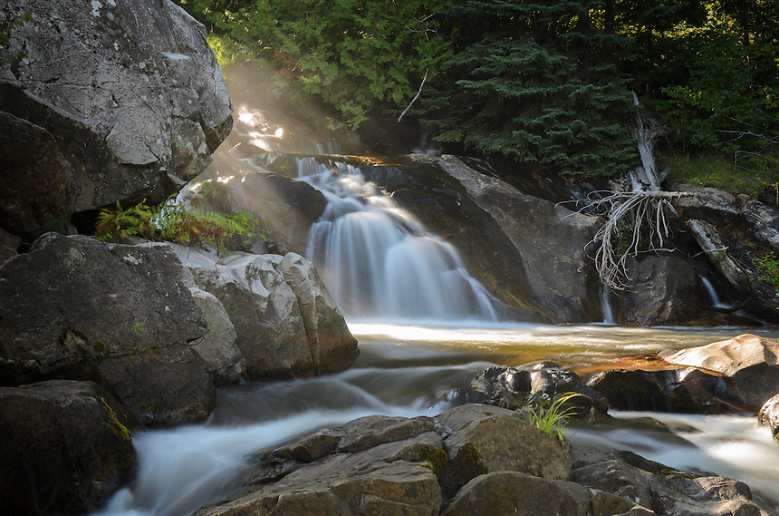 A beautiful sunbeam lighting up a small waterfall on the Yellow Dog River. Marquette County, MI