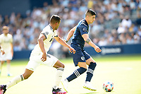 KANSAS CITY, KS - JUNE 26: Alan Pulido #9 Sporting KC with the ball during a game between Los Angeles FC and Sporting Kansas City at Children's Mercy Park on June 26, 2021 in Kansas City, Kansas.