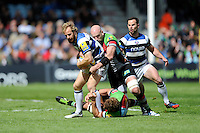 Nick Abendanon of Bath Rugby is tackled by George Robson of Harlequins during the Aviva Premiership match between Harlequins and Bath Rugby at The Twickenham Stoop on Saturday 10th May 2014 (Photo by Rob Munro)