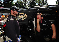 Aug. 7, 2011; Kent, WA, USA; NHRA top fuel dragster driver Del Worsham (right) talks with Shawn Langdon during the Northwest Nationals at Pacific Raceways. Mandatory Credit: Mark J. Rebilas-