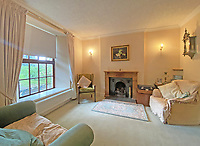 BNPS.co.uk (01202 558833)<br /> Pic: LillicrapChilcott/BNPS<br /> <br /> Pictured: The snug.<br /> <br /> A sprawling waterfront estate that has been in the same family for half a century is on the market for £2.25m.<br /> <br /> Bellscat Farmhouse is a pretty Grade II listed home with beautiful far-reaching views over Fowey River in Cornwall.<br /> <br /> The grand four-bedroom home looks a far cry from a typical farmhouse and is believed to have been two farm cottages that were converted into one home.<br /> <br /> There is also a separate two-bedroom barn and the properties sit in 37 acres of undulating land, creating a private and scenic estate.