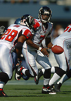 Sep 18, 2005; Seattle, WA, USA; Atlanta Falcons quarterback Michael Vick #7 hands off the ball against the Seattle Seahawks in the first quarter at Qwest Field. Mandatory Credit: Photo By Mark J. Rebilas