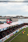 Dagenham and Redbridge 1 Burton Albion 3, 21/02/2015. Victoria Road, League Two. The television cameras precariously placed on the north terrace stand capture the action below. Burton Albion moved to the top of League Two following a hard-fought win over Dagenham & Redbridge played in-front of 1,718 supporters. Photo by Simon Gill.