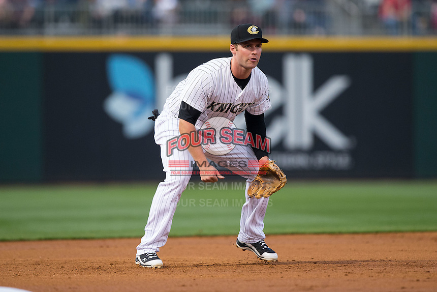 Charlotte Knights third baseman Matt Davidson (22) on defense against the Durham Bulls at BB&T BallPark on April 14, 2016 in Charlotte, North Carolina.  The Bulls defeated the Knights 2-0.  (Brian Westerholt/Four Seam Images)