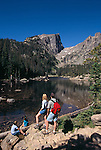 A family of four hiking at Dream Lake in Rocky Mtn Nat'l Park, CO