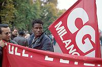 - Milan, African immigrant with the CGIL flag during a trade-union demonstration ..- Milano, immigrato africano con bandiera della CGIL durante una manifestazione sindacale
