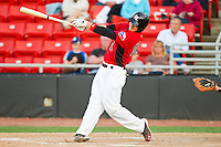 Kellin Deglan #15 of the Hickory Crawdads follows through on his swing against the Augusta GreenJackets at L.P. Frans Stadium on April 29, 2011 in Hickory, North Carolina.   Photo by Brian Westerholt / Four Seam Images