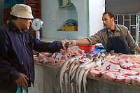 Tripoli, Libya - Fish Market, Rashid Street, Customer Paying for a Purchase.