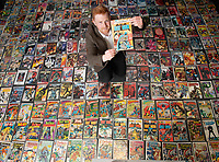 BNPS.co.uk (01202 558833)<br /> Pic: ZacharyCulpin/BNPS<br /> <br /> Auctioneer, Andy Wooller goes through the collection<br /> <br /> A huge comic collection immaculately accumulated over 60 years by a late fanatic has been found by his family. <br /> <br /> The vast archive of over 8,000 comics was amassed by bachelor Peter James who kept them in pristine condition at his home.<br /> <br /> He was introduced to comics by his mother as a young boy as she thought it would encourage him to read.<br /> <br /> He started collecting at the age of 10 and kept the magazines neatly stacked in boxes.
