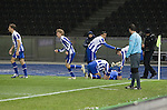 Hertha Berlin 1 Sporting Lisbon 0, 16/12/2010. Olympic Stadium, Europa League. Home striker Gojko Kacar (on ground) is congratulated by teammates after scoring the only goal as Hertha Berlin take on Sporting Lisbon at the Olympic Stadium in Berlin in the group stages of the UEFA Europa League. Hertha won the match by 1 goal to nil to press to the knock-out round of the cup. 2009/10 was the the first year in which the Europa League replaced the UEFA Cup in European football competition. Photo by Colin McPherson.