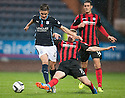 Dundee's Thomas Konrad is challenged by St Johnstone's David Wotherspoon.