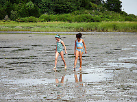 Two girls exploring the tidal flats, Cape Cod, MA
