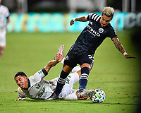 LAKE BUENA VISTA, FL - AUGUST 01: Ronald Matarrita #22 of New York City FC knocks Marvin Loría #44 of the Portland Timbers off the ball and dribbles away during a game between Portland Timbers and New York City FC at ESPN Wide World of Sports on August 01, 2020 in Lake Buena Vista, Florida.