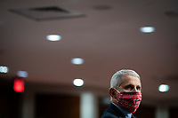 Anthony Fauci, director of the National Institute of Allergy and Infectious Diseases, wears a face covering as he listens during a Senate Health, Education, Labor and Pensions Committee hearing in Washington, D.C., U.S., on Tuesday, June 30, 2020. Top federal health officials are expected to discuss efforts to get back to work and school during the coronavirus pandemic. <br /> Credit: Al Drago/CNP/AdMedia