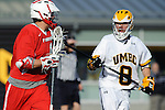 Baltimore, MD - March 3:  Defensemen Sam McKelvey #8 of the UMBC Retrievers  defends Attackmen Drew Federico #6 of the Fairfield Stags during the Fairfield v UMBC mens lacrosse game at UMBC Stadium on March 3, 2012 in Baltimore, MD.
