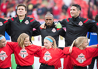 Toronto, Ontario - May 17, 2014: Toronto FC forward Jermain Defoe #18 and Toronto FC goalkeeper Joe Bendik #12 during the opening ceremonies in a game between the New York Red Bulls and Toronto FC at BMO Field. Toronto FC won 2-0.