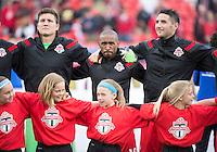 Toronto, Ontario - May 17, 2014: Toronto FC forward Jermain Defoe #18 and Toronto FC goalkeeper Joe Bendik #12 during the opening ceremonies in a game between the New York Red Bulls and Toronto FC at BMO Field. Toronto FC won 2-0.