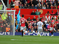 Pictured: Swansea goalkeeper Lukasz Fabianski (L) saves the ball from a Wayne Rooney free kick. Saturday 16 August 2014<br />