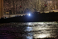 Pictured: Locals flash a light over the river Towy bridge to see the level of the water in Carmarthen, Wales, UK. Saturday 13 October 2018<br /> Re: River Towy has burst its banks and adjacent properties have flooded, caused by storm Callum, in Carmarthen, west Wales, UK.