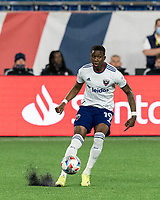 FOXBOROUGH, MA - APRIL 24: Nigel Robertha #19 of D.C. United passes the ball during a game between D.C. United and New England Revolution at Gillette Stadium on April 24, 2021 in Foxborough, Massachusetts.