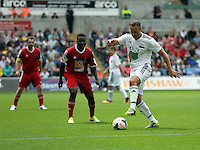 Pictured: Lee Trundle (R) of Team Woodyatt passing the ball. Sunday, 01 June 2014<br /> Re: Celebrities v Celebrities football game organised by Sellebrity Scoccer, in aid of Swansea City Community Trust, at the Liberty Stadium, south Wales.