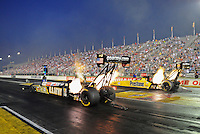 Sept. 2, 2011; Claremont, IN, USA: NHRA top fuel dragster driver Tony Schumacher (left) races alongside teammate Spencer Massey during qualifying for the US Nationals at Lucas Oil Raceway. Mandatory Credit: Mark J. Rebilas-