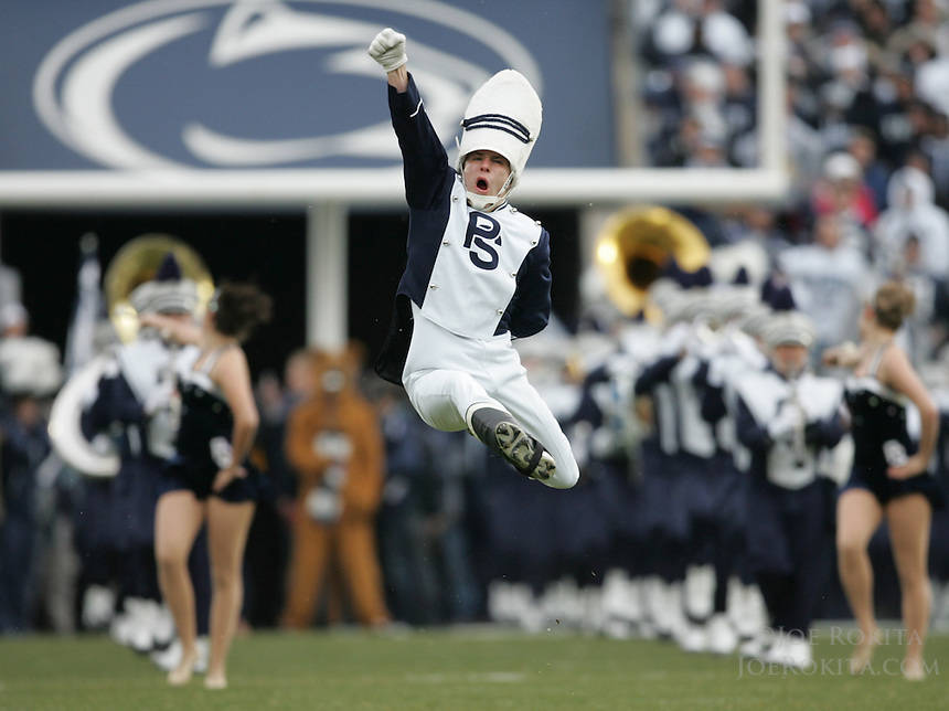 State College, PA - 11/27/2010:  Penn State drum major Ian Kenney lifts a fist to the air after successfully completing his forward flip during the pre-game festivities.  Penn State lost to Michigan State by a score of 28-22 on Senior Day at Beaver Stadium...Photo:  Joe Rokita / JoeRokita.com..Photo ©2010 Joe Rokita Photography