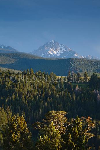 Sun spot lighting a peak in the Anaconda Pintler Mountain Range