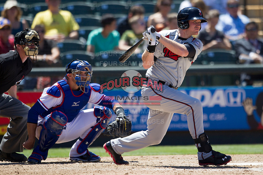 Nashville Sounds first baseman Hunter Morris (15) follows through on his swing against the Round Rock Express in the Pacific Coast League baseball game on May 5, 2013 at the Dell Diamond in Round Rock, Texas. Round Rock defeated Nashville 5-1. (Andrew Woolley/Four Seam Images).