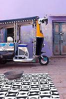 A rickshaw is parked in the courtyard of the Adarsh Vidya Mandir school