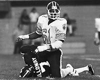 Bruce Smith Toronto Argonauts sacks Ottawa Rough Rider Quarterback Condredge Holloway. Copyright photograph Scott Grant