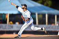 Asheville Tourists starting pitcher Jake Bird (33) delivers a pitch during a game against the Lakewood BlueClaws at McCormick Field on August 6, 2019 in Asheville, North Carolina. The Tourists defeated the BlueClaws 5-2. (Tony Farlow/Four Seam Images)