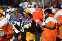 NEW YORK - NOVEMBER 7: Volunteers at a fluid station hand out water and Gatorade to runners during the 2010 New York City Marathon.