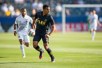 CARSON, CA - MAY 8: Eddie Segura #4 of LAFC looking for an open man during a game between Los Angeles FC and Los Angeles Galaxy at Dignity Health Sports Park on May 8, 2021 in Carson, California.