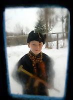 UKRAINE, 01.2008, Kosmach. Huzulen, Volk der Karpaten: Junge vor der Tuer. | Hutsuls - People of the Carpathians: Boy outside the door..© Cyril Horiszny/EST&OST