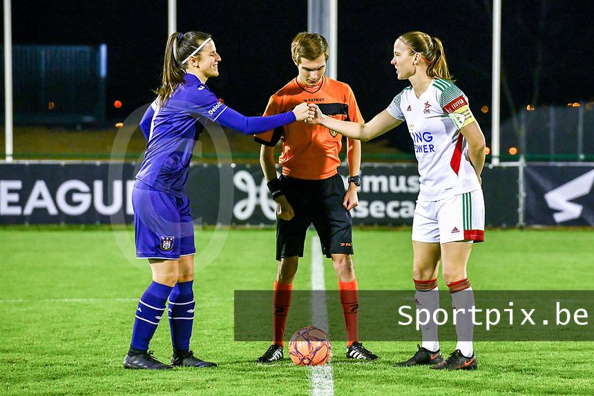 Laura De Neve (8) of Anderlecht , referee Christopher Pottier and Lenie Onzia (8) of OHL pictured before a female soccer game between RSC Anderlecht Dames and Oud Heverlee Leuven on the 11 th matchday of the 2020 - 2021 season of Belgian Womens Super League , friday 22 nd of January 2021  in Tubize , Belgium . PHOTO SPORTPIX.BE | SPP | STIJN AUDOOREN