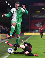 12th January 2021; Vitality Stadium, Bournemouth, Dorset, England; English Football League Championship Football, Bournemouth Athletic versus Millwall; Diego Rico of Bournemouth tackles Kenneth Zohore of Millwall