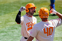 Tennessee Volunteers catcher Connor Pavolony (17) celebrates with Luc Lipcius (40) following a home run against the Florida Gators on Robert M. Lindsay Field at Lindsey Nelson Stadium on April 11, 2021, in Knoxville, Tennessee. (Danny Parker/Four Seam Images)
