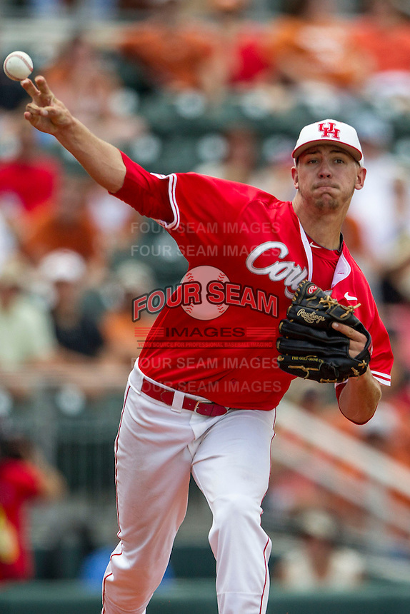 Houston Cougars pitcher Jake Lemoine (26) makes a pickoff throw to first base during the NCAA baseball game against the Texas Longhorns on June 6, 2014 at UFCU Disch–Falk Field in Austin, Texas. The Longhorns defeated the Cougars 4-2 in Game 1 of the NCAA Super Regional. (Andrew Woolley/Four Seam Images)