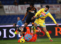 Calcio, semifinale di andata di Coppa Italia: Roma vs Napoli. Roma, stadio Olimpico, 5 febbraio 2014.<br /> AS Roma forward Gervinho, of Ivory Coast, left, runs on his way to score as Napoli defender Raul Albiol, of Spain, tries to stop him during the Italian Cup first leg semifinal football match between AS Roma and Napoli at Rome's Olympic stadium, 5 February 2014. At bottom, Napoli goalkeeper Jose' Manuel Reina, of Spain, lies on the pitch.<br /> UPDATE IMAGES PRESS/Riccardo De Luca
