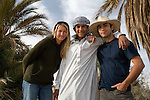 Deddeda and Sean pose for a self-portrait with Gomha, their local Siwan guide and donkey-cart driver in the Siwa Oasis, Egypt, during an early morning sunrise photo shoot.