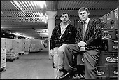Al and Matt Reilly in their underground wholesale drinks warehouse in the King's Cross Goods Yard.  The business has an annual turnover of £4 million; London 1989.