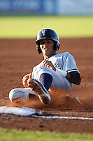 Staten Island Yankees Mason Williams #59 slides into third on a triple during a game against the Batavia Muckdogs at Dwyer Stadium on July 29, 2011 in Batavia, New York.  Staten Island defeated Batavia 10-7.  (Mike Janes/Four Seam Images)