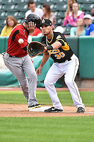 Roberto Lopez (30) of the Salt Lake Bees in action against the Albuquerque Isotopes at Smith's Ballpark on May 21, 2014 in Salt Lake City, Utah.  (Stephen Smith/Four Seam Images)