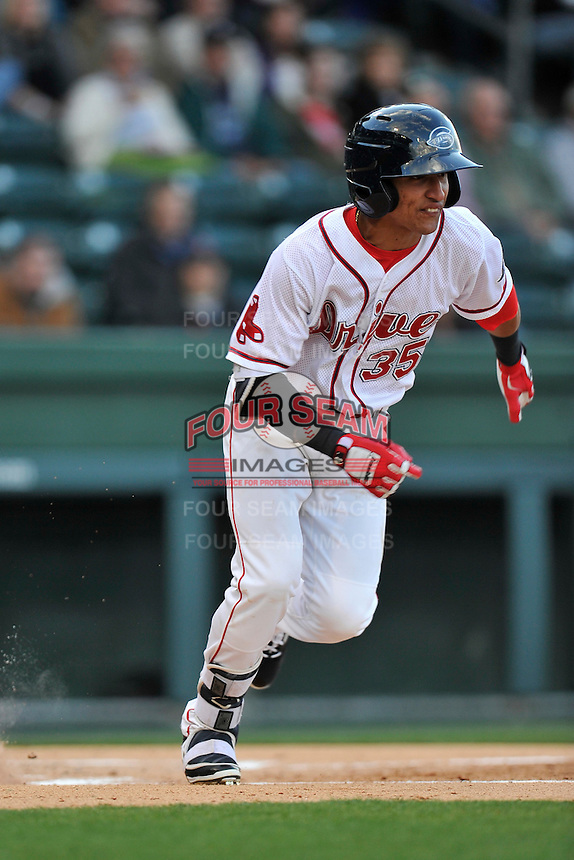 Shortstop Jeremy Rivera (35) of the Greenville Drive runs toward first base in a game against the Asheville Tourists on Thursday, April 7, 2016, at Fluor Field at the West End in Greenville, South Carolina. Greenville won, 4-3. (Tom Priddy/Four Seam Images)