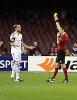 Thursday 27 February 2014<br /> Pictured: Chico Flores of Swansea (L) sees a yellow card by match refereeOvidiu Alin Hategan (R)<br /> Re: UEFA Europa League, SSC Napoli v Swansea City FC at Stadio San Paolo, Naples, Italy.