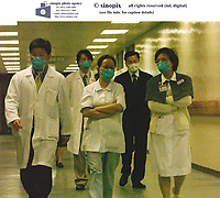 Doctors walk the corridors at the Prince of Wales Hospital in Hong Kong, which is the center of the new Asian flu epidemic which has spread to severeal counries around the world.