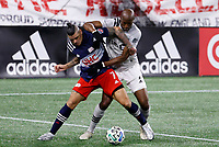 20th November 2020; Foxborough, MA, USA;  Montreal Impact midfielder Rod Fanni clamps down on New England Revolution forward Gustavo Bou during the MLS Cup Play-In game between the New England Revolution and the Montreal Impact