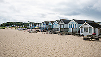 BNPS.co.uk (01202 558833)<br /> Pic: MaxWillcock/BNPS<br /> <br /> With video: https://youtu.be/YhZrWp9eNF4<br /> <br /> Pictured: The beach hut for sale (second from right).<br /> <br /> The prices of Britain's most expensive beach huts are on course to break through the £400,000 barrier due to the huge demand for them by rich staycationers. <br /> <br /> The wooden cabins at Mudeford in Christchurch, Dorset, have always commanded premium prices but they are now selling for more than people pay for a four bedroom house in many parts of the country.<br /> <br /> This week a hut went on the market for an asking price of £355,000, just two weeks after one sold within hours of being listed for £350,000.