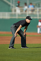 Umpire Harrison Silverman handles the calls on the bases during the Midwest League game between the South Bend Cubs and the Lansing Lugnuts at Cooley Law School Stadium on June 15, 2018 in Lansing, Michigan. The Lugnuts defeated the Cubs 6-4.  (Brian Westerholt/Four Seam Images)